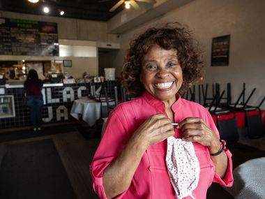 Dorothy Jones, 80, who co-owns D.J.'s Black Jack Pizza with her son Terry, poses for a portrait inside her restaurant, Friday, April 24, 2020 near Fair Park in Dallas. As Gov. Greg Abbott announces plans to reopen Texas businesses, Ms. Jones, while grateful to have stayed open on a pickup-only basis through the coronavirus pandemic, is ready to reopen her dining room as soon as possible.