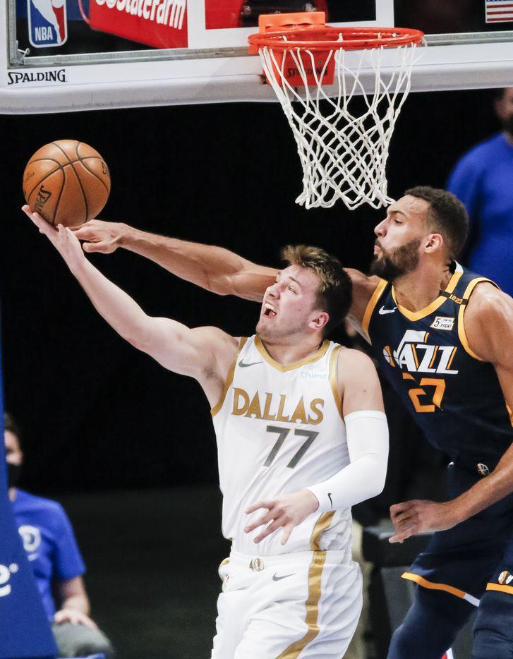 Dallas Mavericks guard Luka Doncic (77) attempts a layup as Utah Jazz forward Rudy Gobert (27) defends during the first half of an NBA basketball game in Dallas, Monday, April 5, 2021. (Brandon Wade/Special Contributor)
