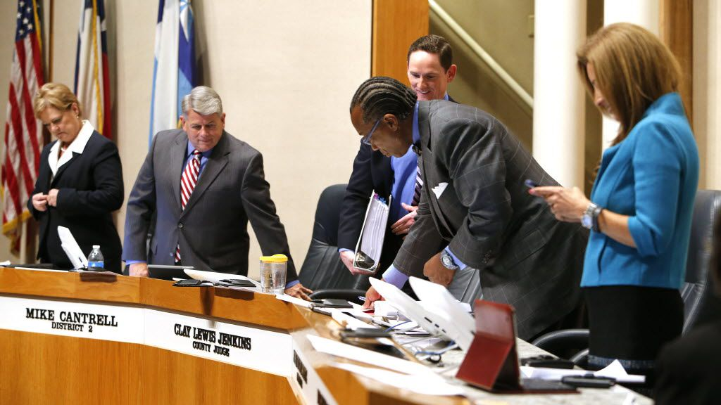 Democrats surround Dallas County Commissioner Mike Cantrell of District 2, the only Republican on the Dallas County Commissioners' Court. From left to right, Commissioner Theresa Daniel, Cantrell, County Judge Clay Jenkins, John Wiley Price and Elba Garcia.