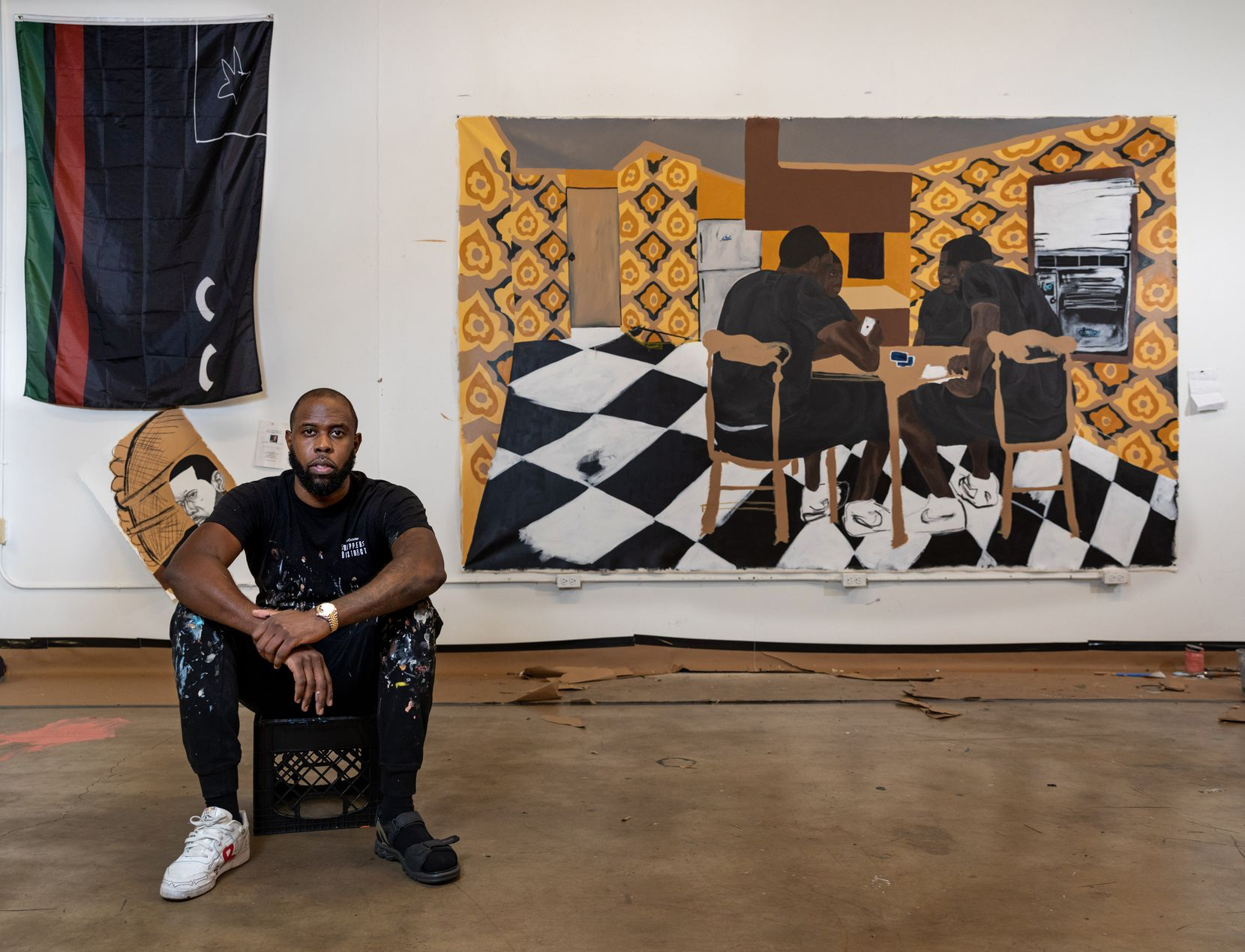 "Artist Jammie Holmes photographed with his painting ""Four Brown Chairs, 2020,"" a new commission for the Dallas Museum of Art. It will be featured in ""To Be Determined,"" a new exhibition opening on Sept. 27. The show will continue through Dec. 27."