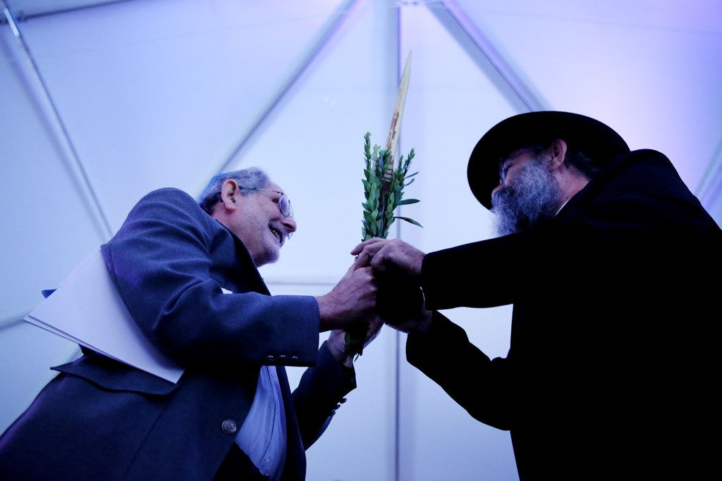 Holocaust survivor Max Spindler (left) holds onto the Lulav while praying with rabbi Mendel Dubrawsky after the groundbreaking ceremony for the new Dallas Holocaust and Human Rights Museum in the West End of Dallas on Oct. 10, 2017. Dubrawsky brought the lulav to the groundbreaking as Jewish communities celebrate the harvest holiday of Sukkot. The ceremony also honored Dallas-Fort Worth Holocaust survivors. At 300 N. Houston St., the museum will be 51,000 square feet and is scheduled to open in the summer of 2019.