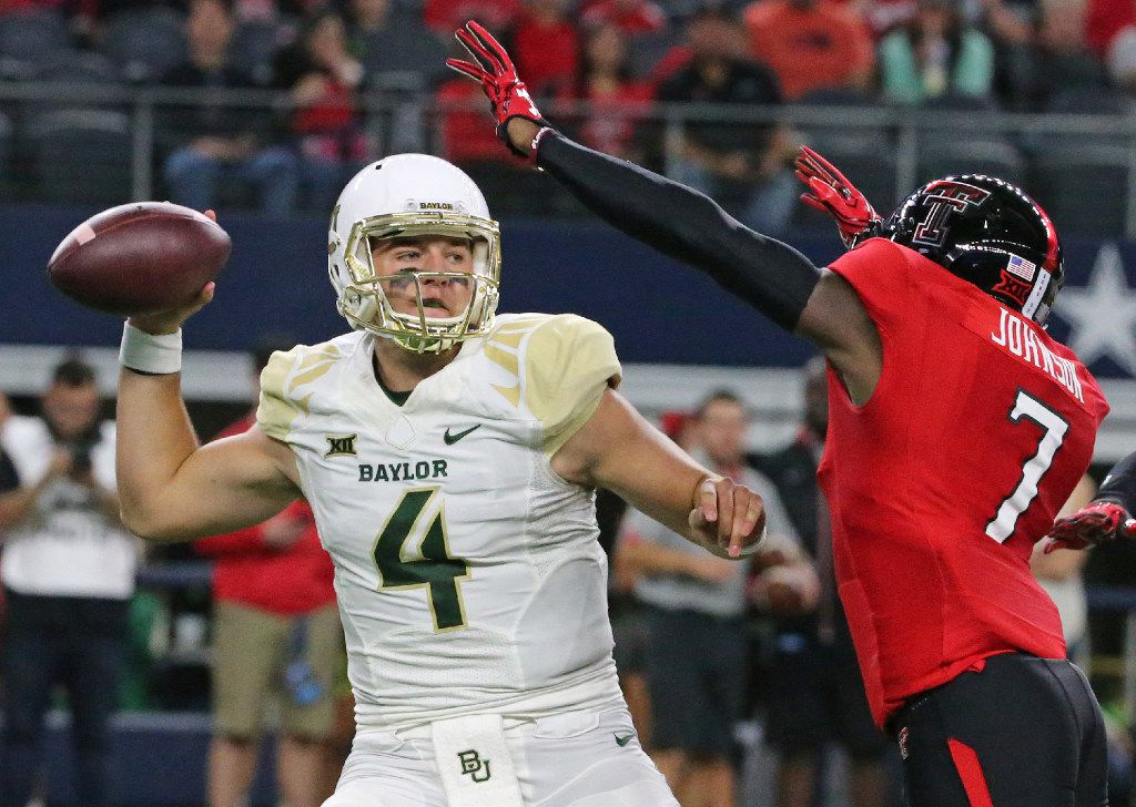 Baylor's Zach Smith (4) gets a pass away under pressure from Texas Tech's Jah'Shawn Johnson (7) in the first quarter during the Baylor University Bears vs. the Texas Tech University Red Raiders NCAA football game at AT&T Stadium in Arlington, Texas on Friday, November 25, 2016. (Louis DeLuca/The Dallas Morning News)