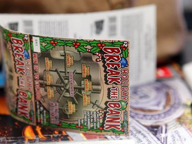 In this 2012 file photo, Texas Lottery scratch tickets are pictured at Cigarette Gallery in Far North Dallas.