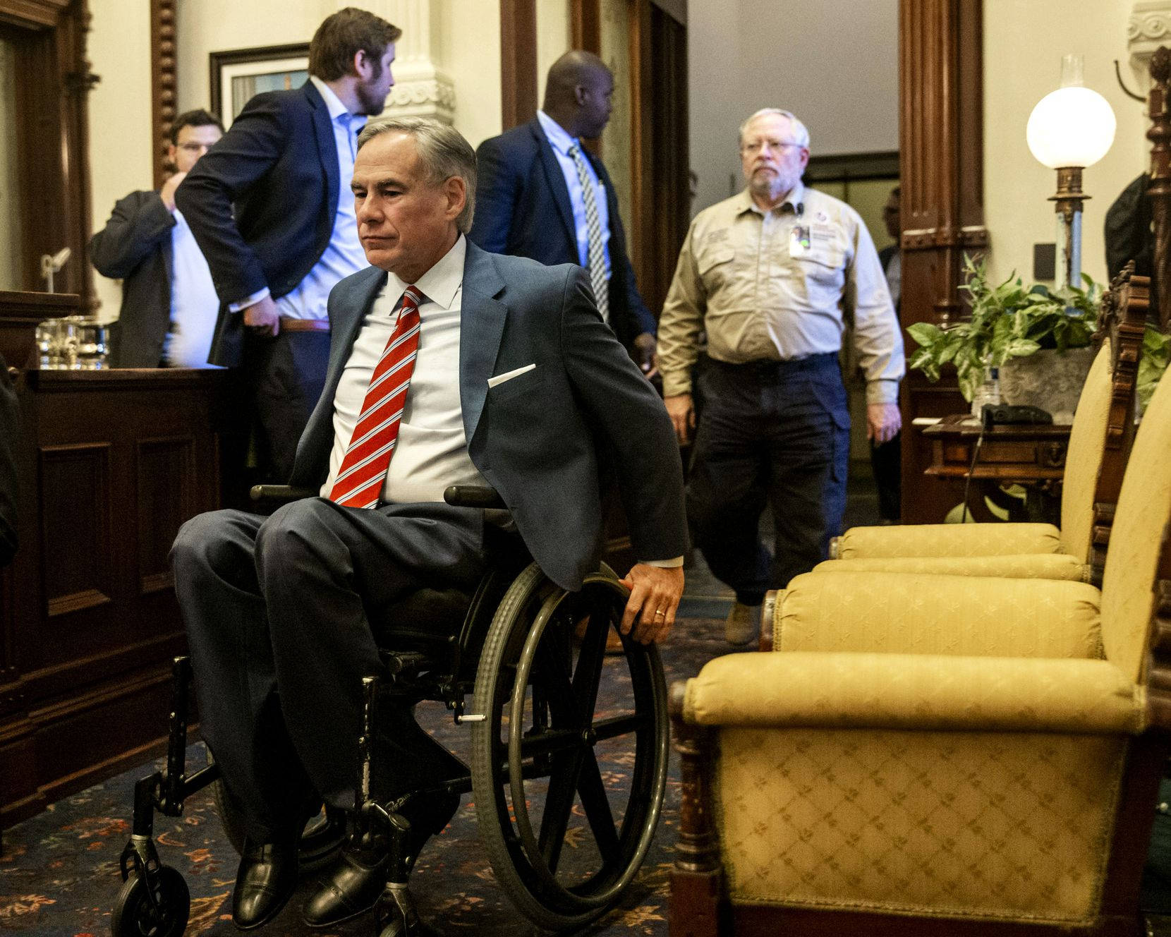 Gov. Greg Abbott, shown entering a May 18 news conference, is using his broad popularity among Republican voters and potent campaign organization to try to propel three state or county-level candidates past rivals associated with Empower Texans in the July 14 runoffs.
