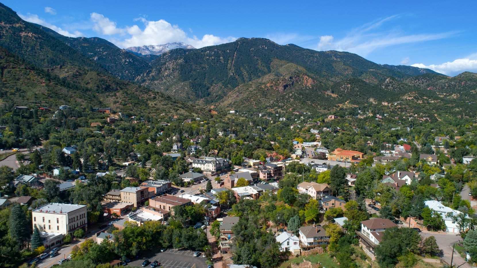 Pikes Peak looms behind the town of Manitou Springs, Colo. The famous Pikes Peak Cog Railway departs from the town.