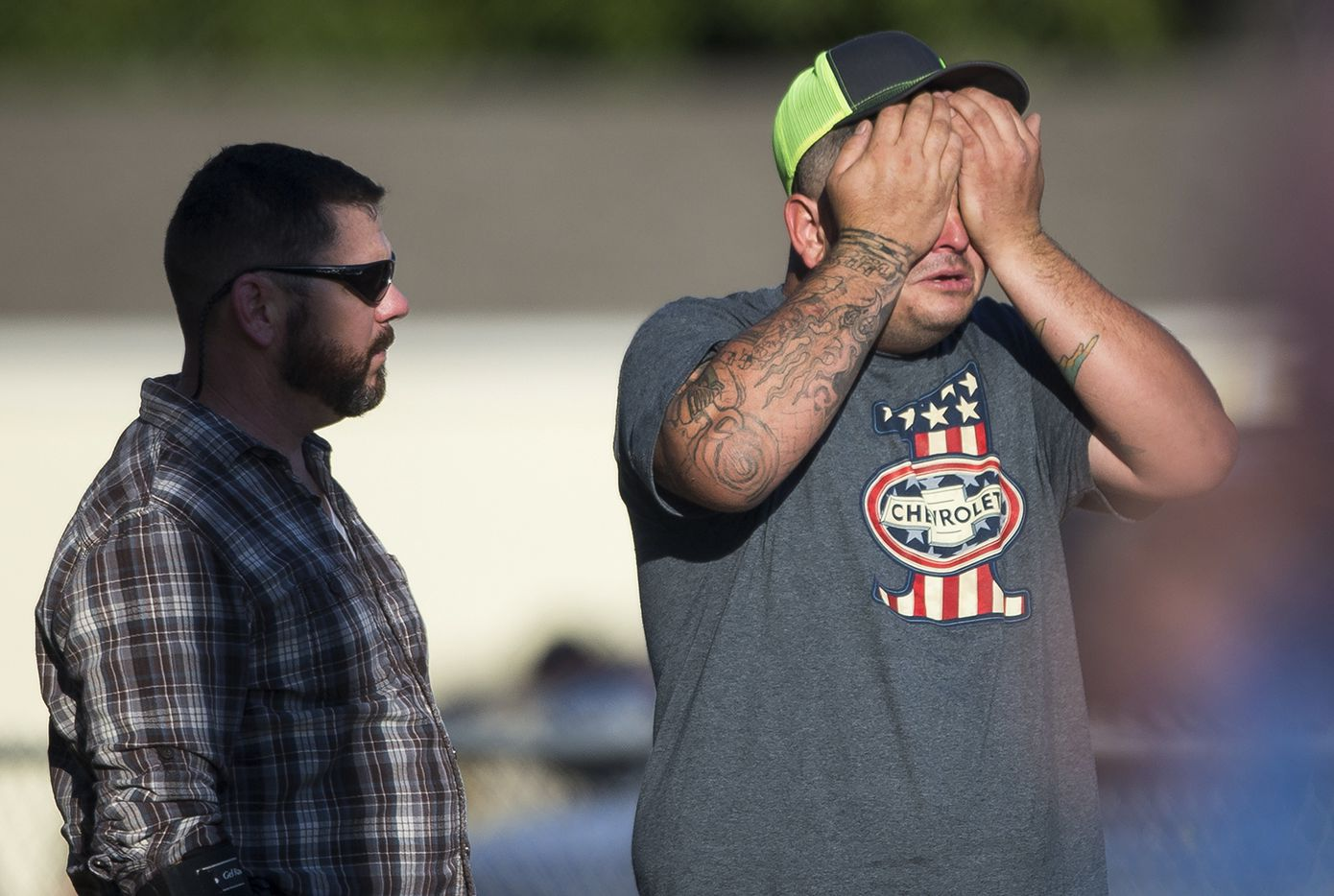 A man wipes his eyes after a deadly shooting at the First Baptist Church in Sutherland Springs, Texas, Sunday, Nov. 5, 2017.