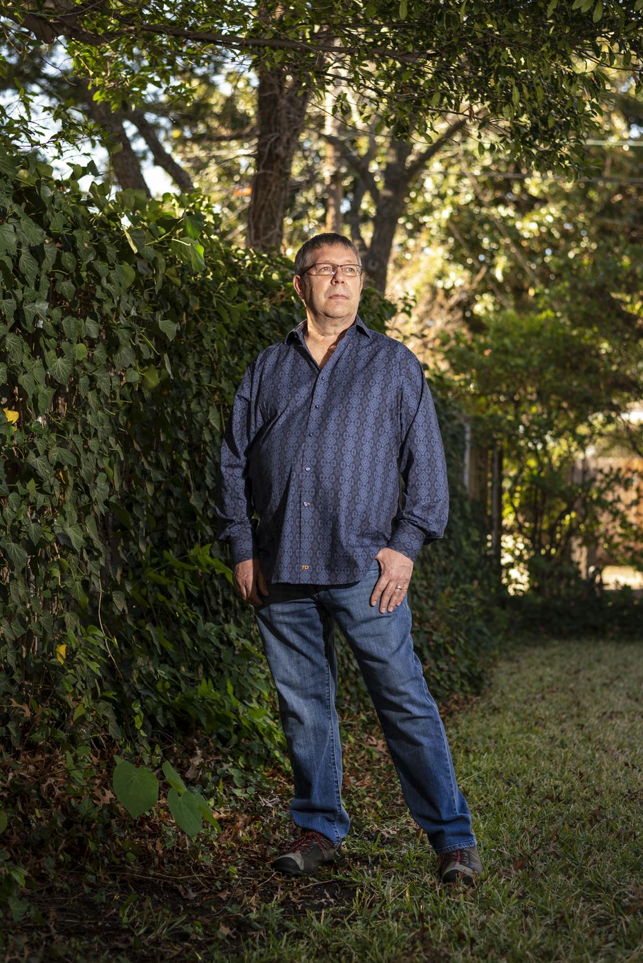 """Scenic artist Robert Winn, 62, outside his home in Dallas, on  Dec. 10, 2020. Winn has worked on numerous Dallas theatrical productions and some of Hollywood's biggest films, including the 2020 sensation, """"Ma Rainey's Black Bottom."""" Winn is also largely responsible for creating Dealey Plaza to look like it did in 1963 for Oliver Stone's """"JFK."""""""