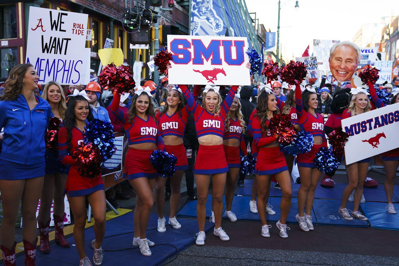 SMU cheerleaders yell on the set of ESPN College GameDay before an NCAA football game between Memphis and SMU on Saturday, Nov. 2, 2019, in Memphis, Tenn.
