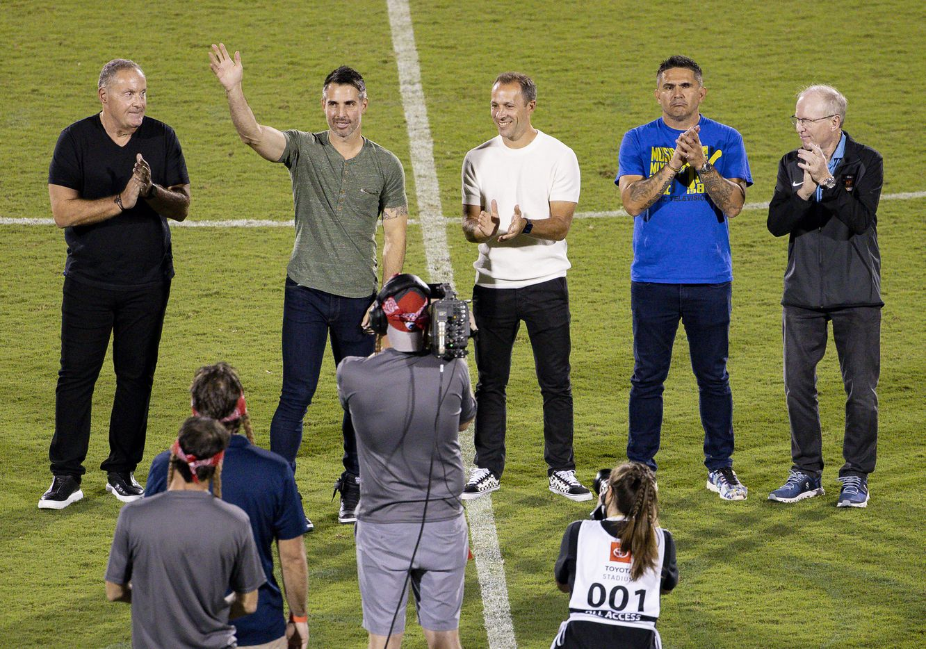 2020 National Soccer Hall of Fame inductee Carlos Bocanegra waves while being introduced with other 2020 and 2021 inductees during the halftime of a FC Dallas against Minnesota United on Saturday, Oct. 2, 2021, at Toyota Stadium in Frisco. (Juan Figueroa/The Dallas Morning News)