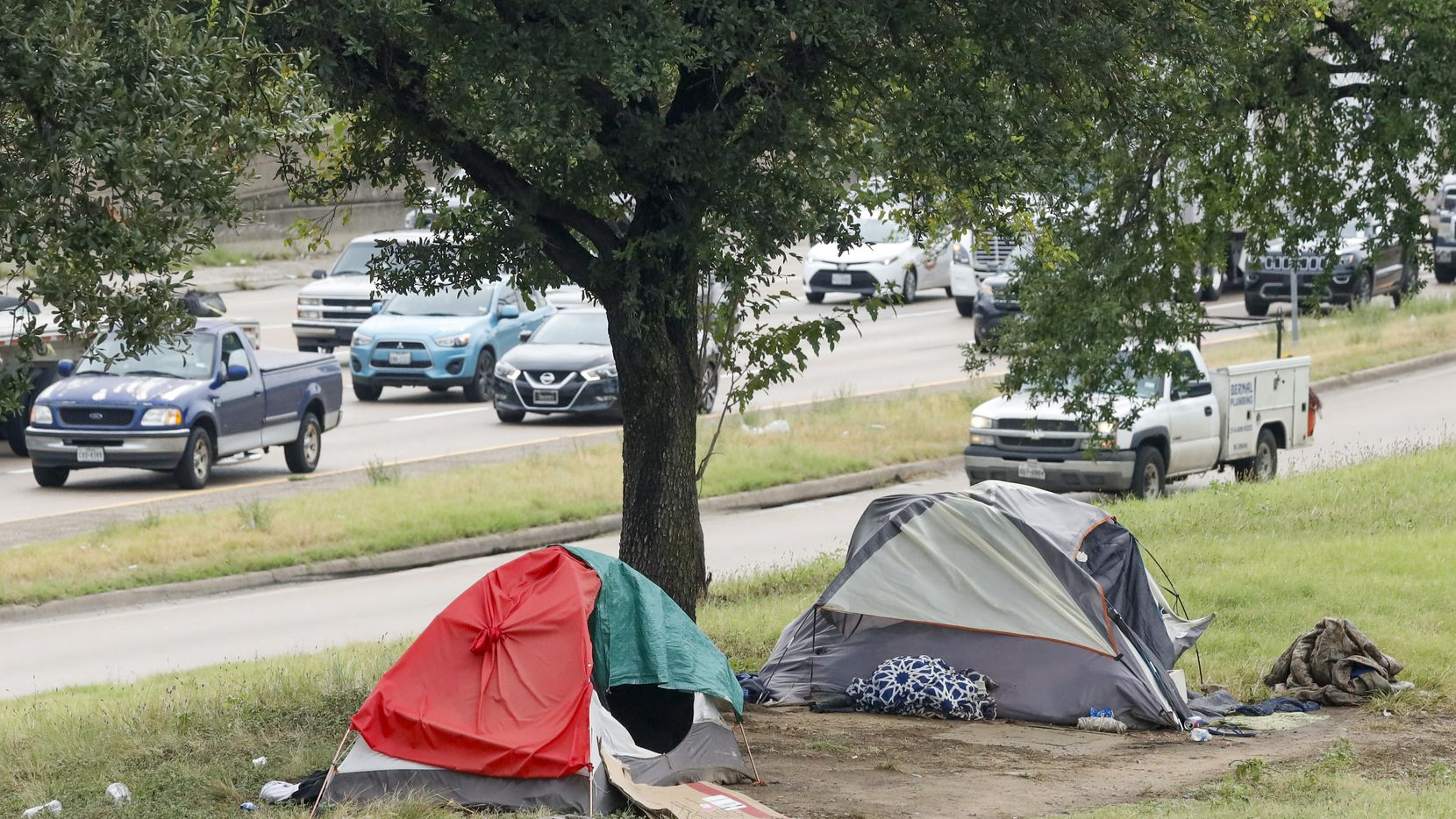 Tents served as makeshift housing against the rain alongside Interstate 30 near downtown Dallas. The City Council will vote Aug. 25 on whether to allocate federal funds to provide permanent housing options.
