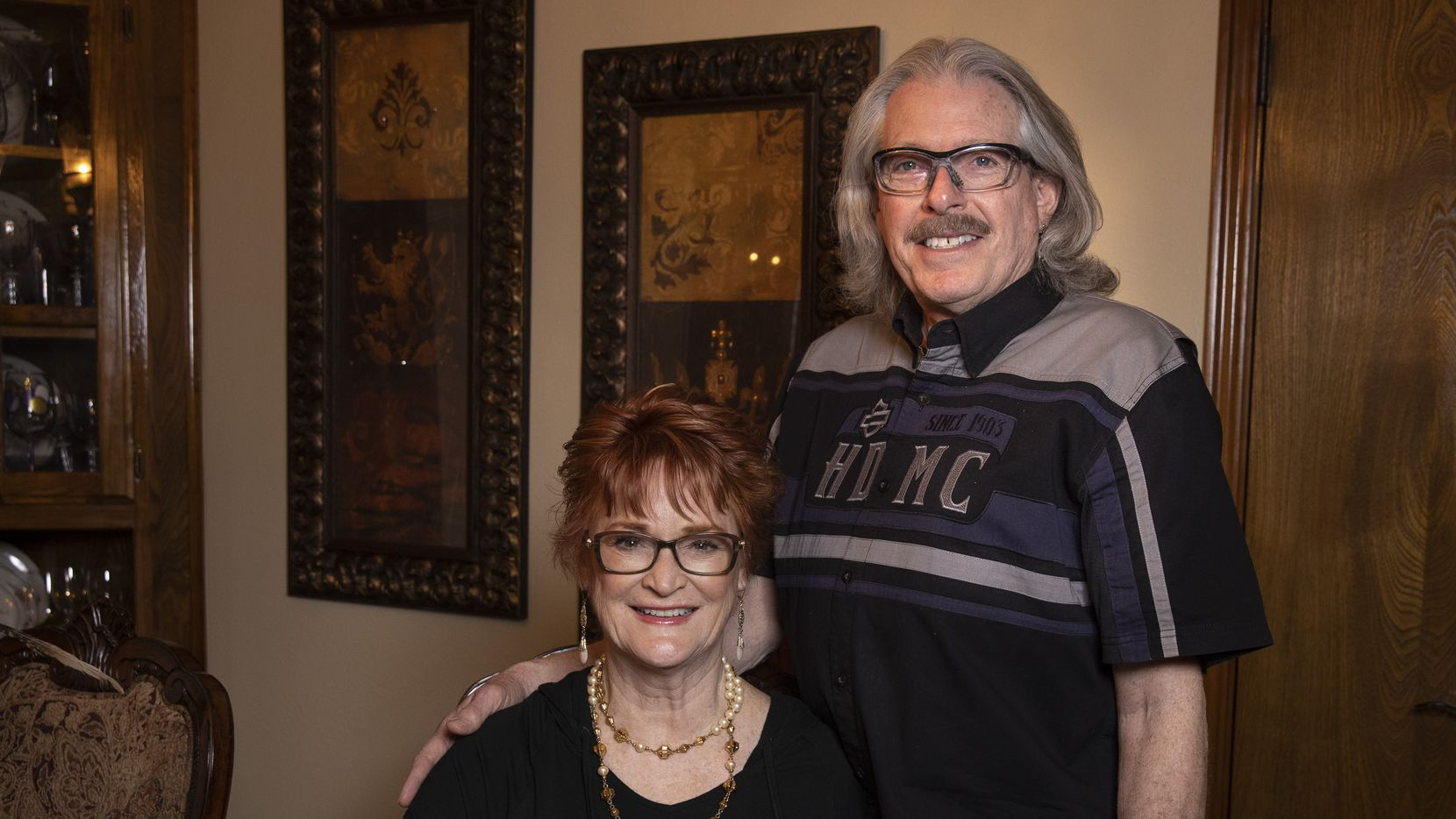 """Anne and Jon Goodman pose for a portrait at their home on Thursday, Feb. 25, 2021, in Fairview, Texas. The couple are both fully vaccinated from COVID-19, and they are looking forward to life post-vaccination. Avid motorcyclists, the pair put a pause on riding during the pandemic. """"We thought even if we got into any small mishap, like even a scrape while riding, we'd be taking someone's spot in the hospital who has COVID,"""" Jon said. """"We decided to put off riding until it got safer."""" (Lynda M. González/The Dallas Morning News)"""