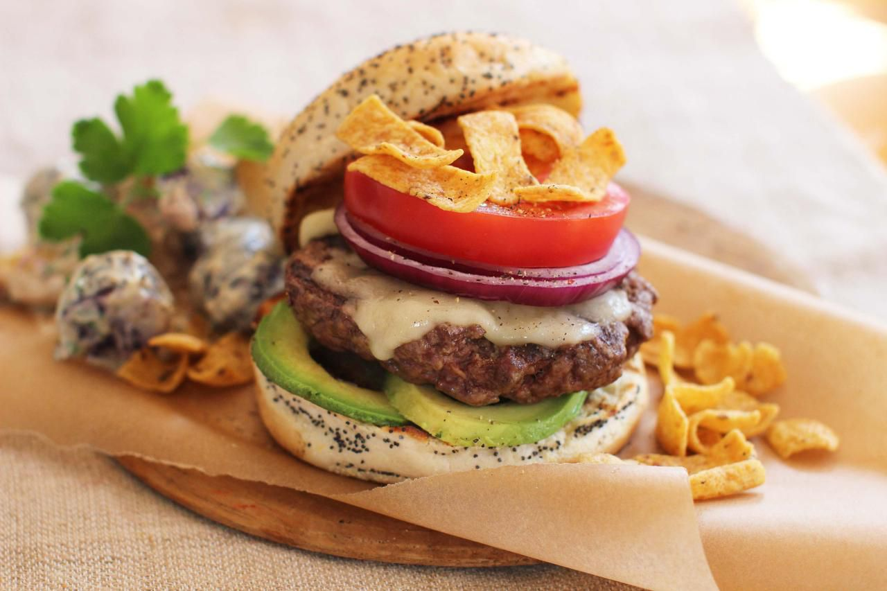 The California Dreaming Burger has cheese, avocado, tomato, red onion and chips.