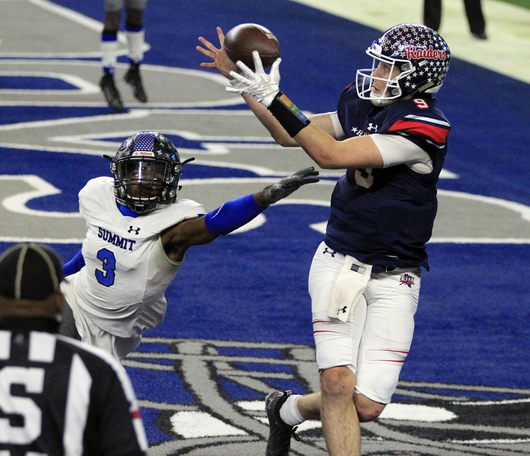 Denton Ryan Seth Henigan (9) catches a touchdown pass over Mansfield Summit's Ahmaad Moses (3) during the second half of the Class 5A Division I state semifinal football playoff game at AT&T Stadium in Arlington on Friday, January 8, 2021. Ryan won 49-35. (John F. Rhodes / Special Contributor)