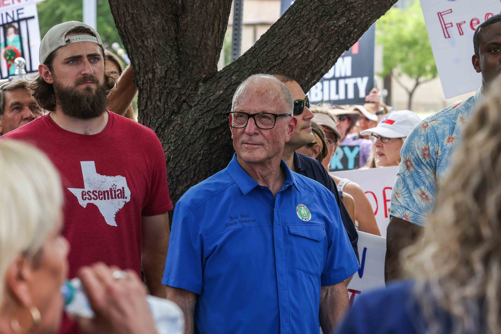 """""""Individual liberty trumps business rights,"""" said state Sen. Bob Hall (center), R-Edgewood, who attended Saturday to support demonstrators."""
