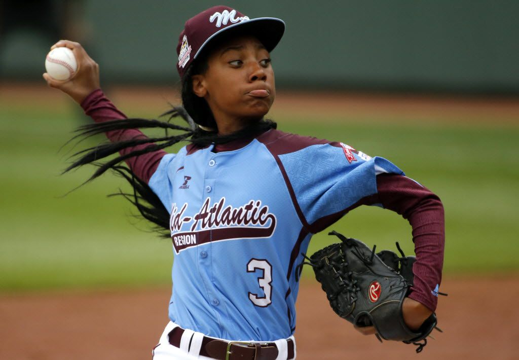 In this Aug. 15, 2014, file photo, Pennsylvania's  Mo'ne Davis delivers in the fifth inning against Tennessee during a baseball game at the Little League World Series tournament in South Williamsport, Pa. Davis was the talk of the sports world and beyond after becoming the first female to win a game in the Little League World Series.