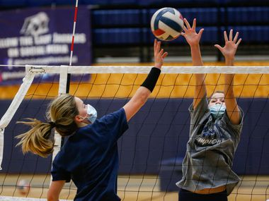 Flower Mound High School volleyball player Gabby Walker (right) goes up to block the ball during practice on Sept. 8, 2020 in Flower Mound.