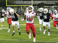 Parish Episcopal's Daniel Demery (14) runs the game opening kickoff back for a touchdown during the first half of a high school football game against Bishop Lynch High at Rofino Stadium in Dallas on Friday, October 15, 2021. (John F. Rhodes / Special Contributor)