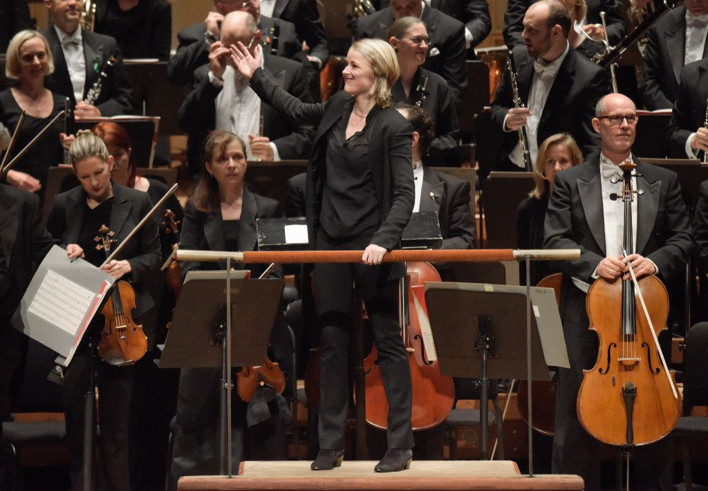 "Conductor Ruth Reinhardt turns the audience after the third movement of Lutoslawski's ""Concerto for Orchestra"" at the Morton H. Meyerson Symphony Center on Thursday, Nov. 17, 2016.  She replaced Stanislaw Skrowaczewski who was to conduct, but suffered a stroke. (Rex C. Curry/Special Contributor)"