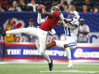 FILE - Alabama cornerback Trevon Diggs (7) intercepts a pass intended for Duke wide receiver Scott Bracey (11) in the second half of a game on Aug. 31, 2019, at Mercedes-Benz Stadium in Atlanta.