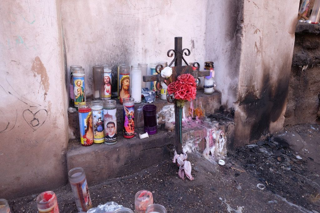 Candles are scattered around a small but fascinating shrine in downtown Tucson.