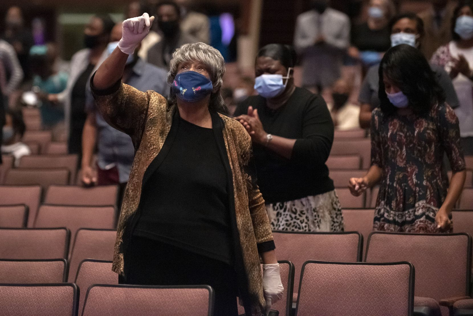 Rosie Phillips-Walker dances and sings during the beginning of Bible study at Full Gospel Holy Temple in Dallas.