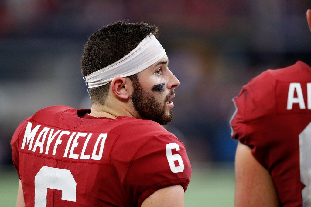 FILE - Oklahoma quarterback Baker Mayfield (6) visits with a teammate on the sideline during the fourth quarter of the Big 12 Championship Game against TCU on Saturday, Dec. 2, 2017, at AT&T Stadium in Arlington. (Tom Fox/The Dallas Morning News)