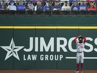 SEQUENCE FOUR-OF-FOUR: Los Angeles Angels right fielder Jo Adell reacts after having a ball go off his glove, and over the fence for a home run by Texas Rangers outfielder Nick Solak during the  fifth inning at Globe Life Field on Sunday, Aug. 9, 2020.