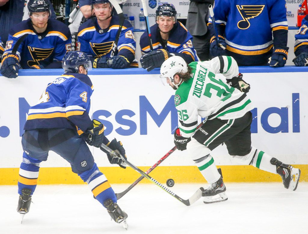 St. Louis Blues defenseman Carl Gunnarsson (4) and Dallas Stars center Mats Zuccarello (36) fight for the puck during game 1 of an NHL second-round playoff series at Enterprise Center in St. Louis Missouri on Thursday, April 25, 2019. (Shaban Athuman/Staff Photographer)