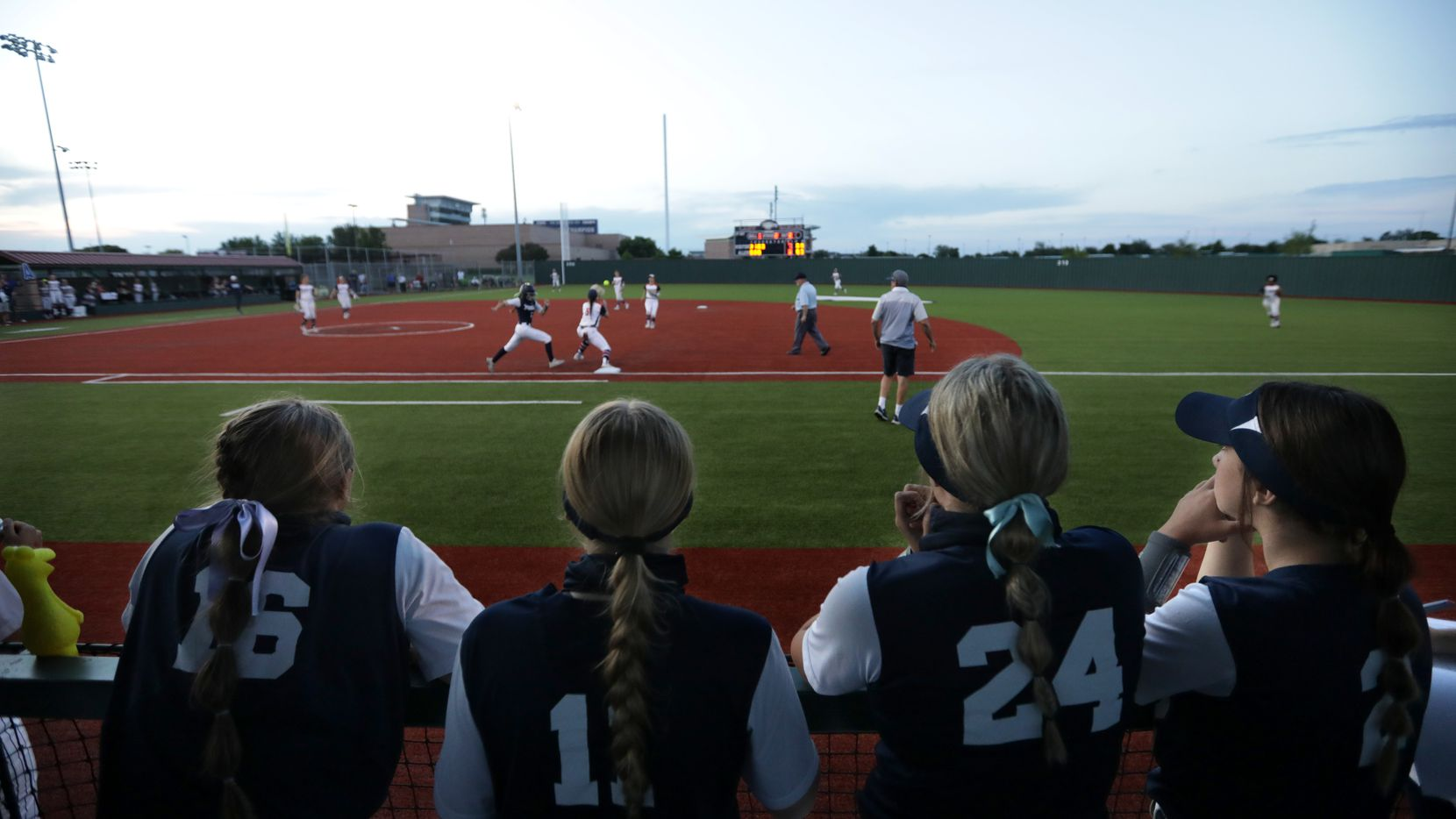 Flower Mound High School players cheer on their team during a softball game against Allen High School at Allen High School in Allen, TX, on May 14, 2021.
