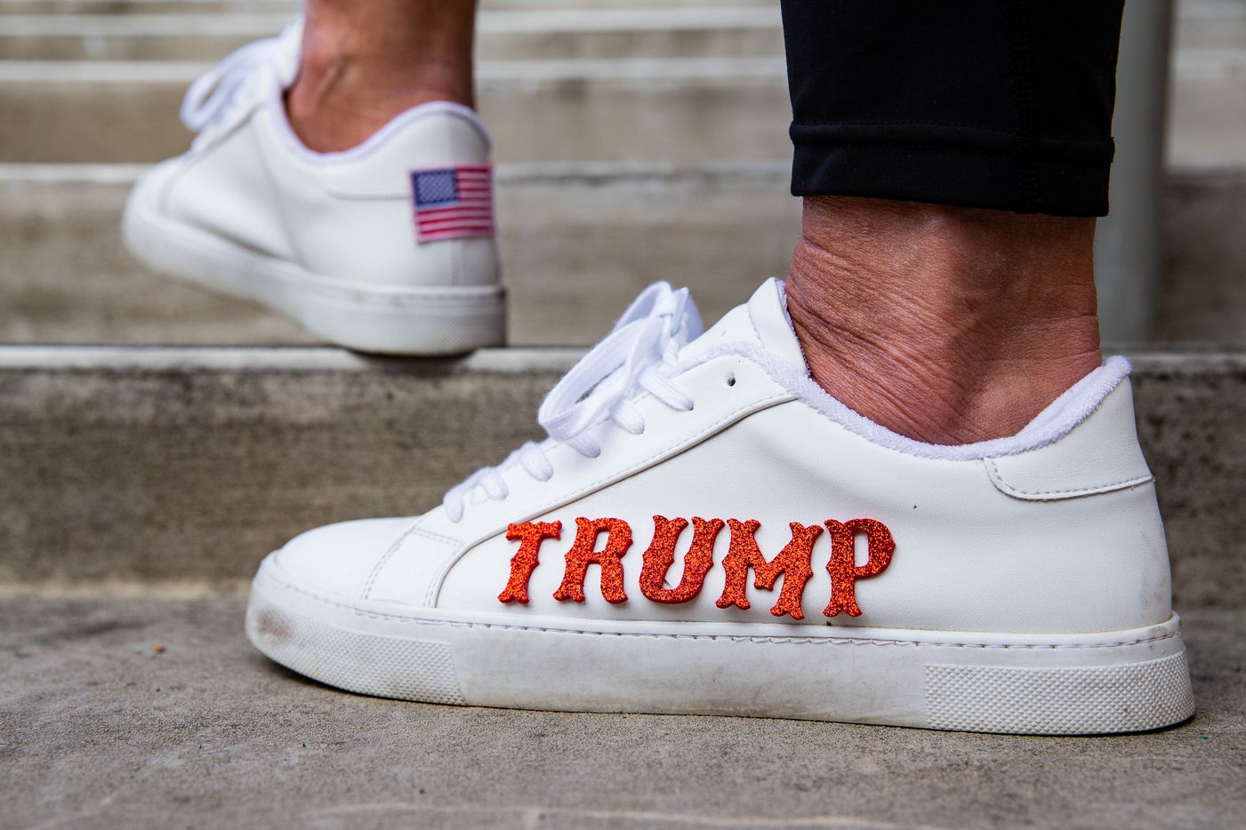 Heather Salazar from McKinney wears shoes with Trump's name during an America is Great rally hosted by TrumpTrain 2020 DFW at Rockwall County Courthouse in Rockwall on Sunday, Nov. 8, 2020. (Juan Figueroa/ The Dallas Morning News)