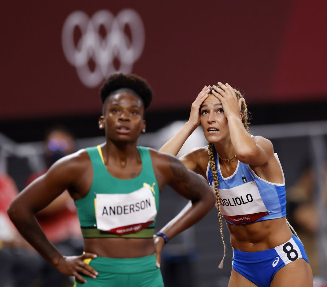 Italy's Luminosa Bogliolo reacts after seeing her final time of 12.75 seconds in the women's semifinal 100 meter hurdles during the postponed 2020 Tokyo Olympics at Olympic Stadium, on Sunday, August 1, 2021, in Tokyo, Japan. Bogliolo failed to advance to the final. Jamaica's Britany Anderson is in front of her and finished with a time of 12.40 seconds and advanced to the final. (Vernon Bryant/The Dallas Morning News)
