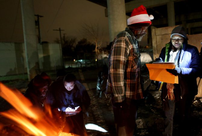 Volunteer Sonya Coleman (right) collects survey information from Sammy Beaty for the annual homeless count in 2019. This year, instead of a one-night volunteer blitz, the count will be conducted by a smaller team of professionals over two weeks.