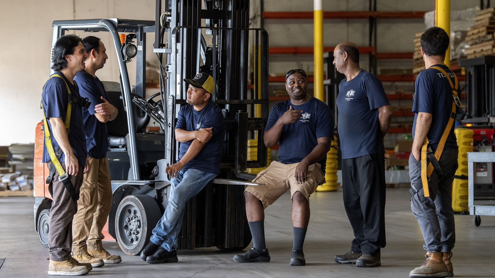 Refugees, such as these workers at Elliott Electrical Supply, contribute more in taxes than they receive in benefits, according to a study on immigrants in Dallas. Statewide, refugees in Texas have over $4.6 billion in spending power.