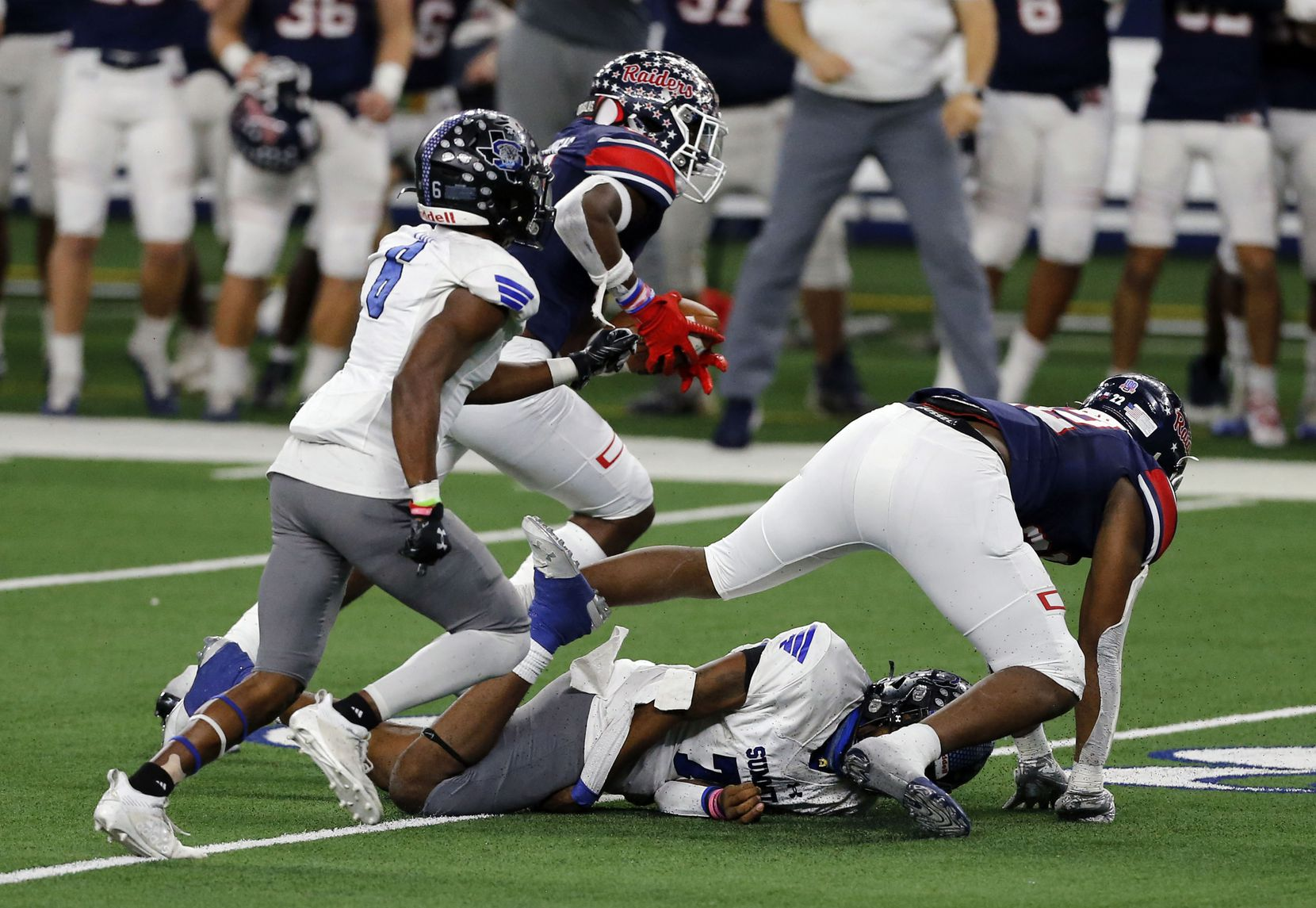 Denton Ryan defender MarQuice Hill Jr. (22) forces a fumble from Mansfield Summit Qb David Hopkins (7). Ryan's DJ Arkansas (21) recovered an advanced it for a touchdown during the second half of the Class 5A Division I state semifinal football playoff game at AT&T Stadium in Arlington on Friday, January 8, 2021. Ryan won 49-35. (John F. Rhodes / Special Contributor)