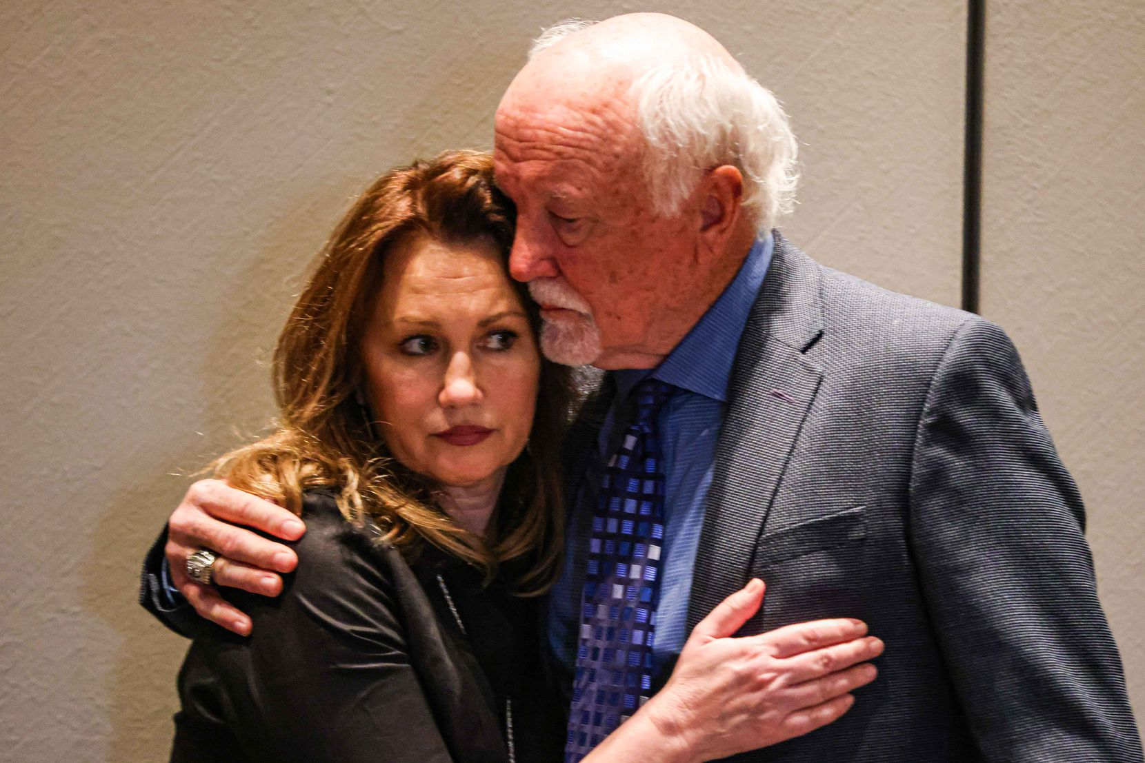 Karen Harris, whose mother was slain in March 2018, and her husband, Dallas Cowboys Hall of Famer Cliff Harris, hugged after Wednesday's news conference in Plano.