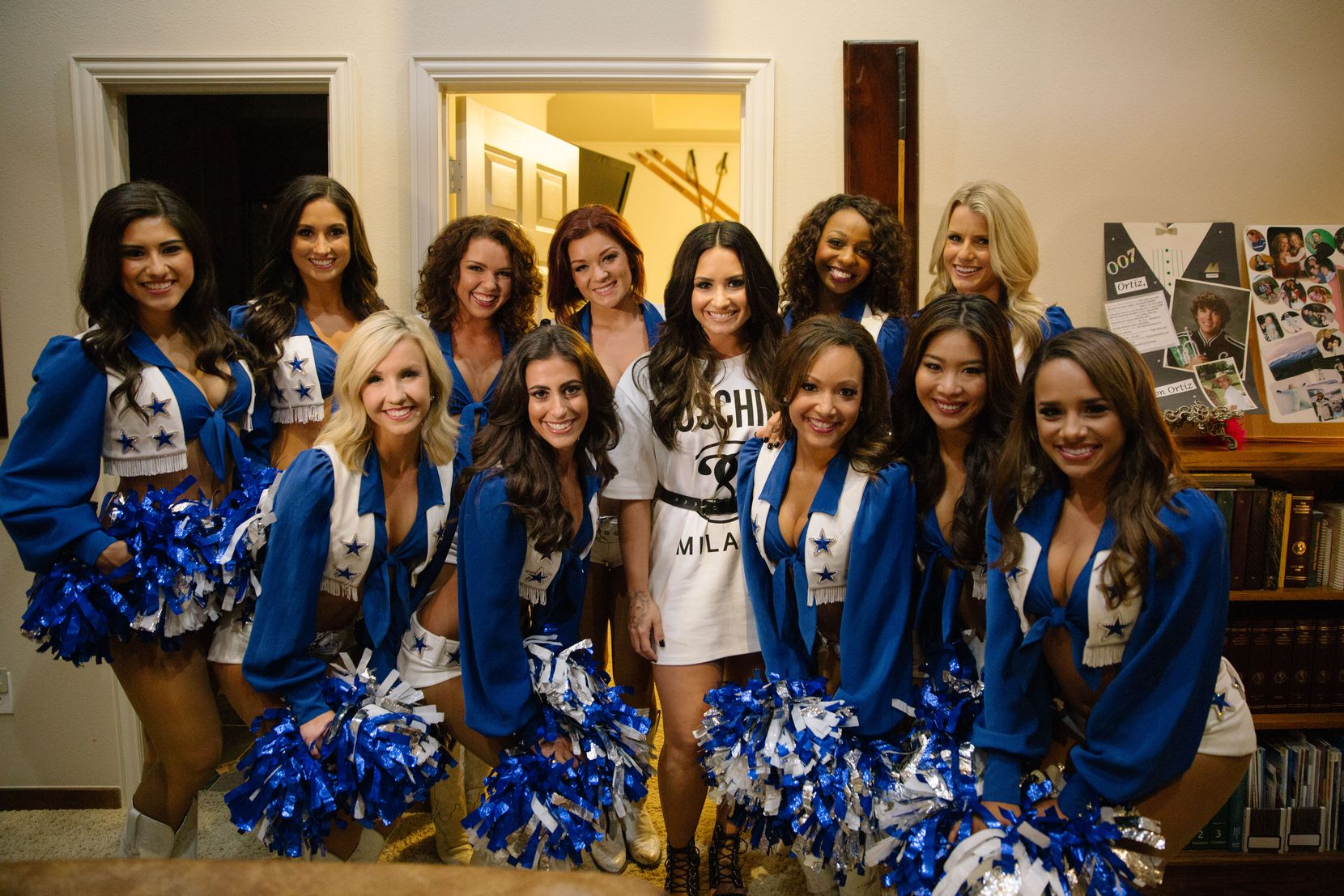 Singer and actress Demi Lovato posed with her special guests, the Dallas Cowboys Cheerleaders, at a house party in Southlake. The squad greeted Lovato when she arrived and joined her onstage for the show.