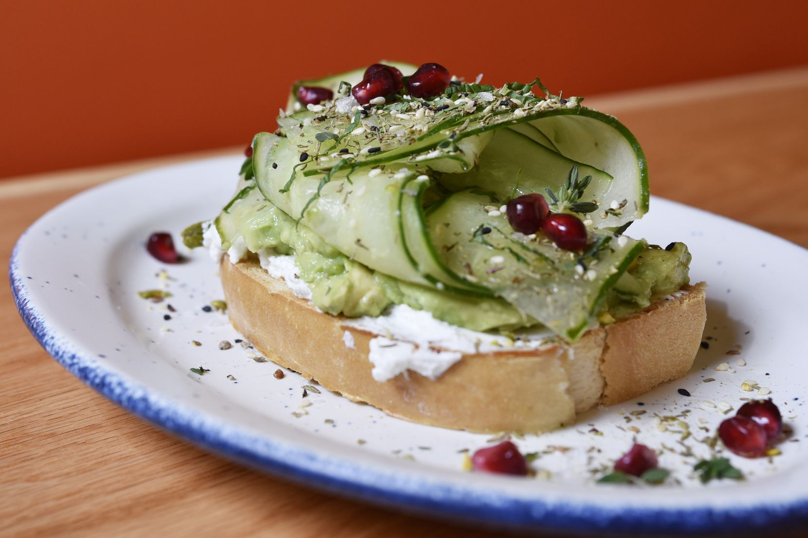 AvoEatery's menu includes six toasts, including this one with za'atar, pistachios, pomegranate and labneh.