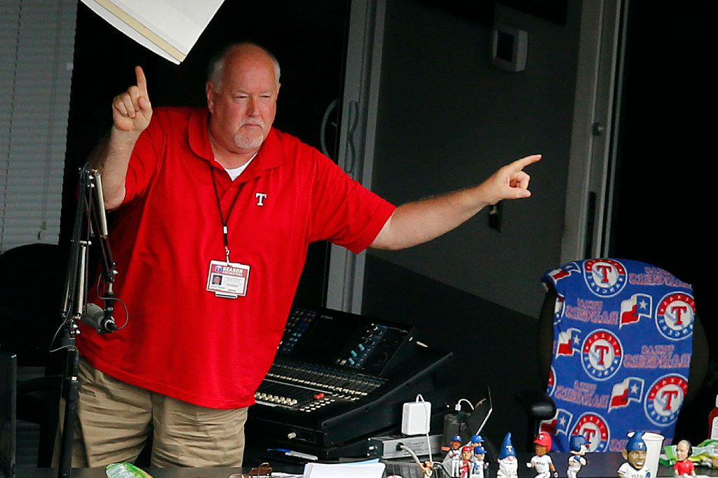 """Texas Rangers announcer Chuck Morgan leads the crowd in a song of """"Take Me Out To The Ballgame"""" during the seventh inning stretch against the Toronto Blue Jays at Globe Life Park in Arlington, Thursday, June 22, 2017. (Tom Fox/The Dallas Morning News)"""