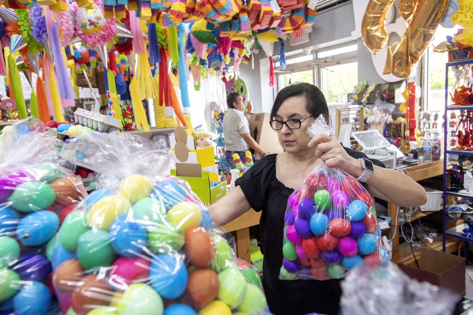 """Elvie De La Fuente says, """"It breaks my heart to know that all these kids did not have their joy, to have their party, to have their piñata,"""" she said as she prepared to pack away many unsold Easter eggs."""