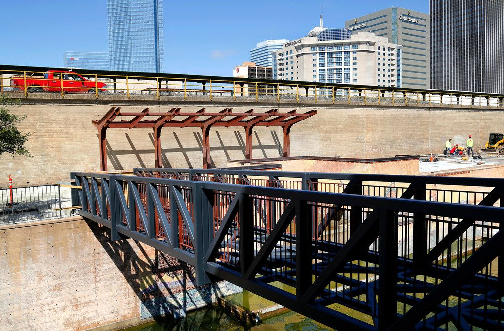 Crews worked last month on a new pedestrian bridge, stairway and shade structures being built at the north end of the Bricktown Canal in Oklahoma City. The popular destination will mark its 20th anniversary this summer.