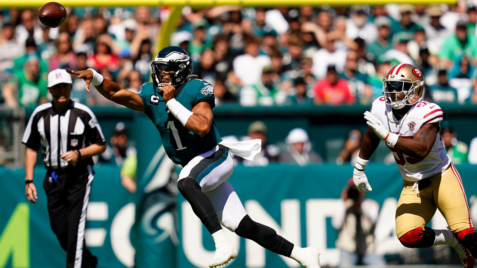 Philadelphia Eagles quarterback Jalen Hurts (1) passes during the first half of an NFL football game against the San Francisco 49ers on Sunday, Sept. 19, 2021, in Philadelphia. (AP Photo/Matt Slocum)