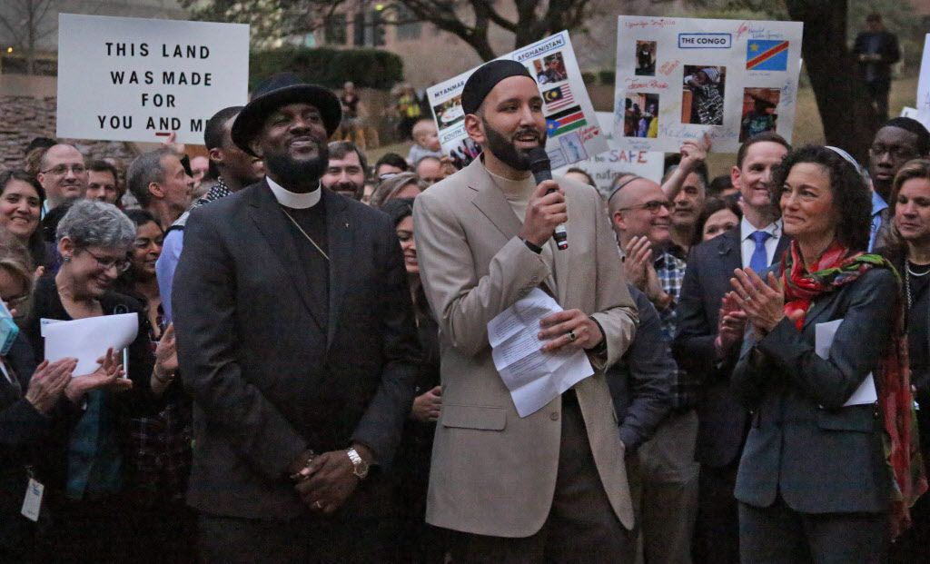 Pastor Michael Waters, Imam Omar Suleiman and Rabbi Nancy Kasten, left to right are pictured during the interfaith vigil to support refugee resettlement in Texas and denounce the Trump administration's executive action on refugee resettlement. photographed at Thanksgiving Square in Dallas on Monday, January 30, 2017.