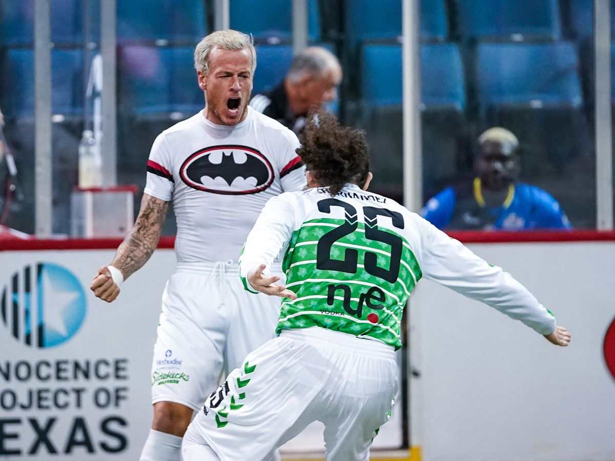 Jamie Lovegrove, wearing a batman shirt, celebrates a goal for the Dallas Sidekicks with #25 Nestor Hernandez. (2-14-19)