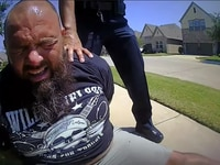 In this screen grab from police body-cam video, Marco Puente grimaces after being pepper-sprayed by a Keller officer.