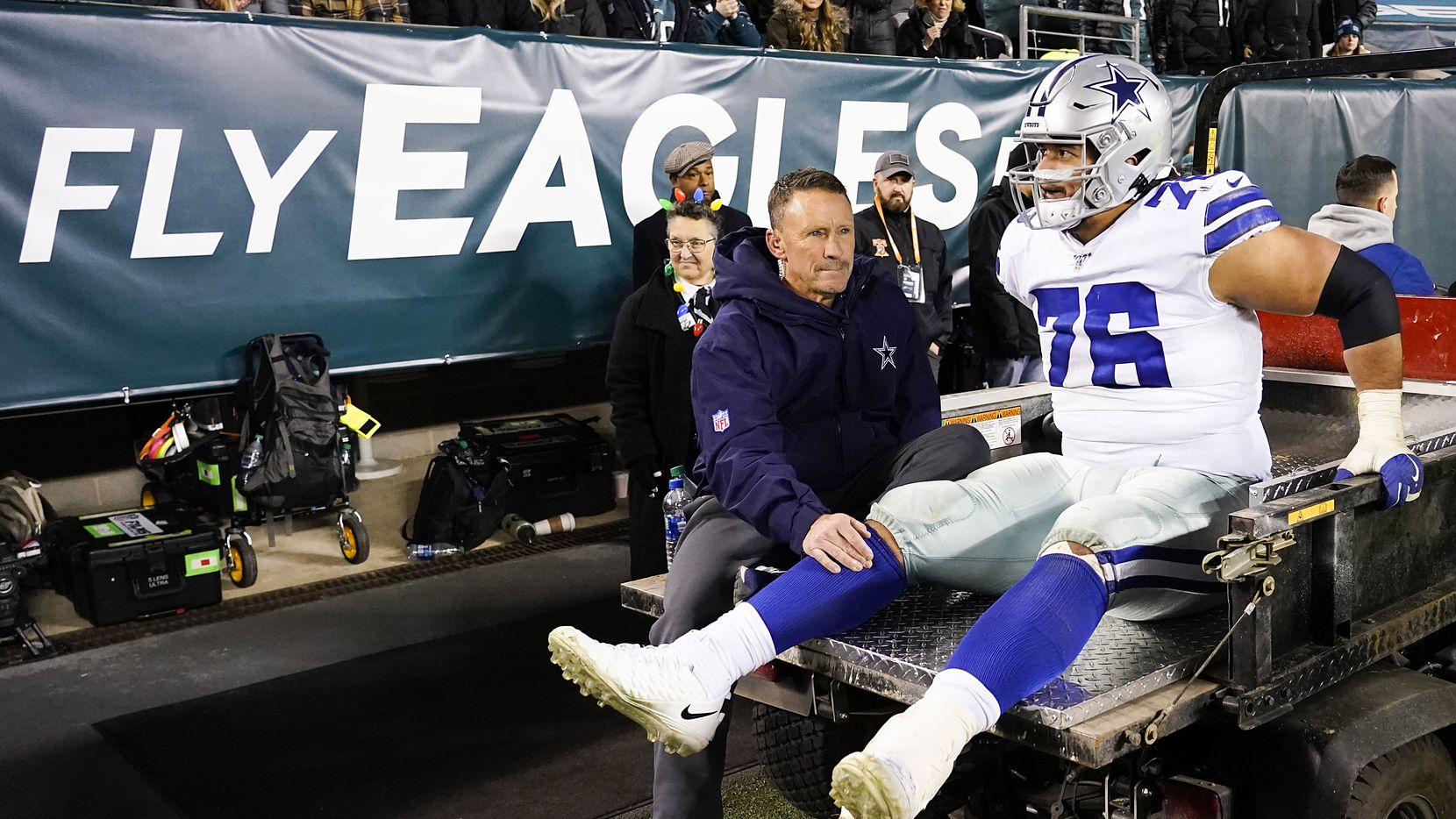 Dallas Cowboys offensive guard Xavier Su'a-Filo leaves the field on a cart after being injured during the second half of an NFL football game against the Philadelphia Eagles at Lincoln Financial Field on Sunday, Dec. 22, 2019, in Philadelphia.