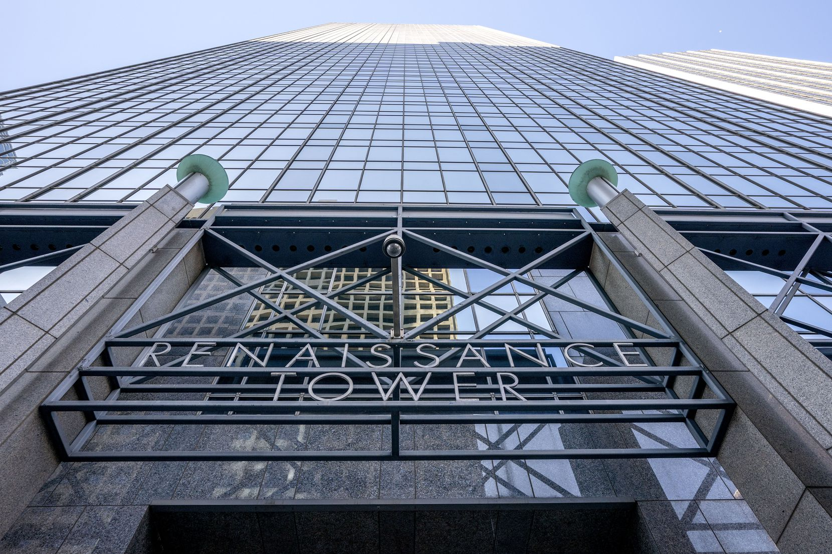 A sign marks the Elm Street entrance to Renaissance Tower. The building was declared in default of mortgages in December.
