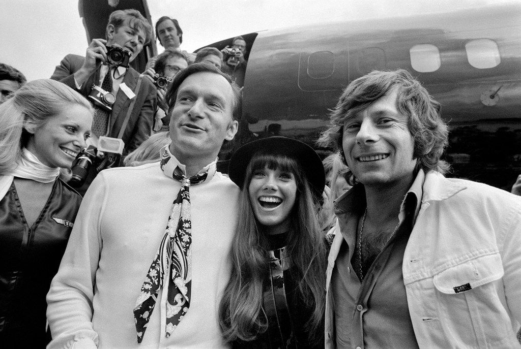 "(FILES) This file photo taken on August 21, 1970 shows shows US Playboy Magazine publisher Hugh Hefner (L), his girlfriend actress Barbara Benton and film director Roman Polanski (R) arriving at Le Bourget airport with the Playboy jet ""Big Bunny"".  Playboy founder Hugh Hefner has died at age 91, the magazine announced Wednesday, September 27, 2017."