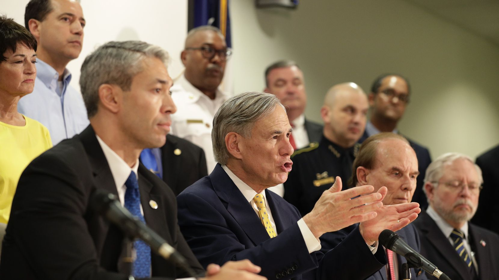 Texas Gov. Greg Abbott, center, is joined by state and city officials as he gives an update on the coronavirus outbreak, Monday, March 16, 2020, in San Antonio.