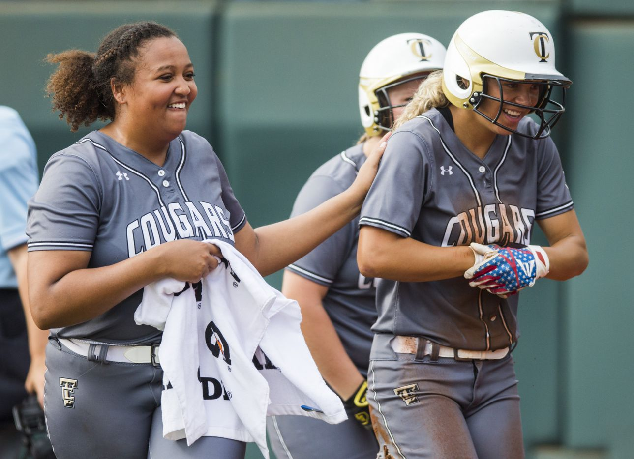 The Colony's Jayda Coleman (10, right) celebrates a run with pitcher Karlie Charles (29) during the first inning of a UIL Class 5A state semifinal softball game between The Colony and Corpus Christi Calallen on Friday, May 31, 2019 at Red & Charline McCombs Field at the University of Texas in Austin. (Ashley Landis/The Dallas Morning News)