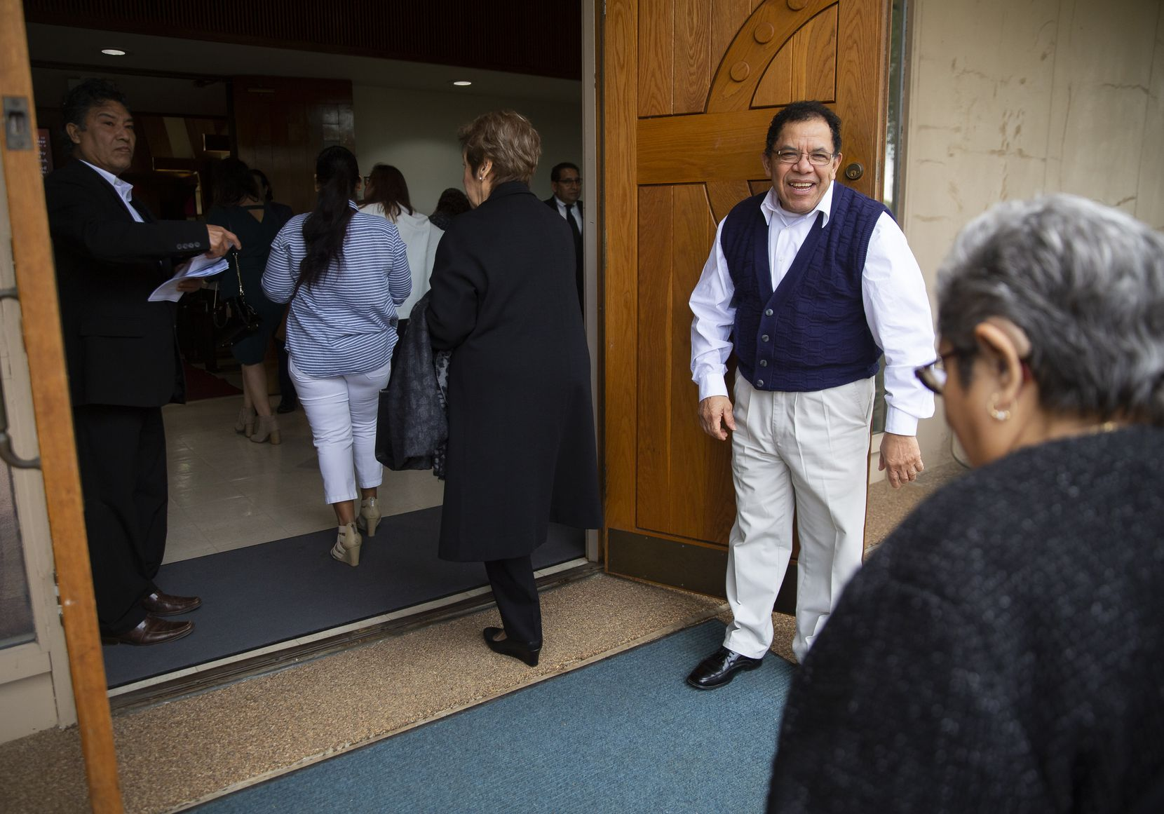 Juan Mejia (right) welcomed members of the First Mexican Baptist Church congregation into their new location Sunday morning.